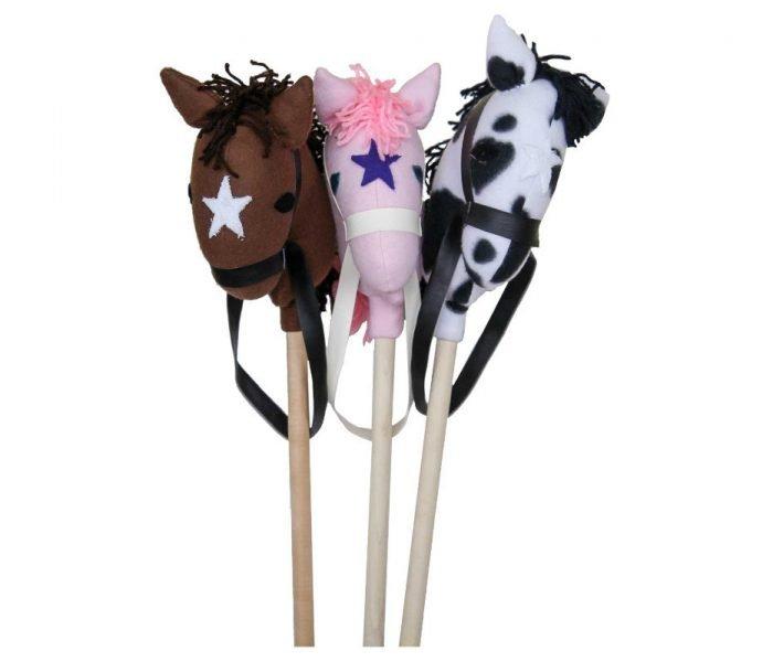 Handmade kids wooden toys stick horses.
